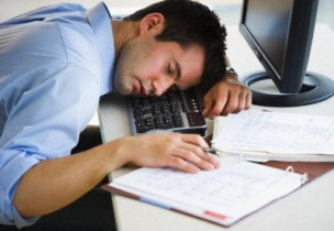 Businessman asleep at his desk --- Image by © Tetra Images/Tetra Images/Corbis
